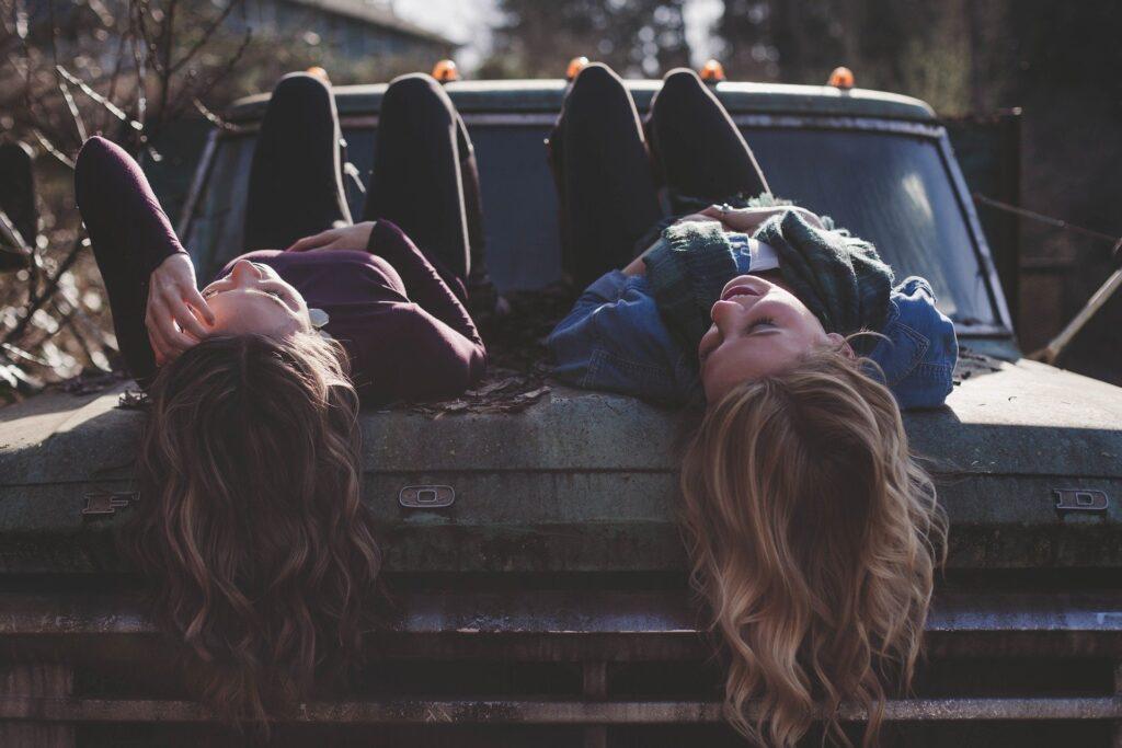 women on truck talking